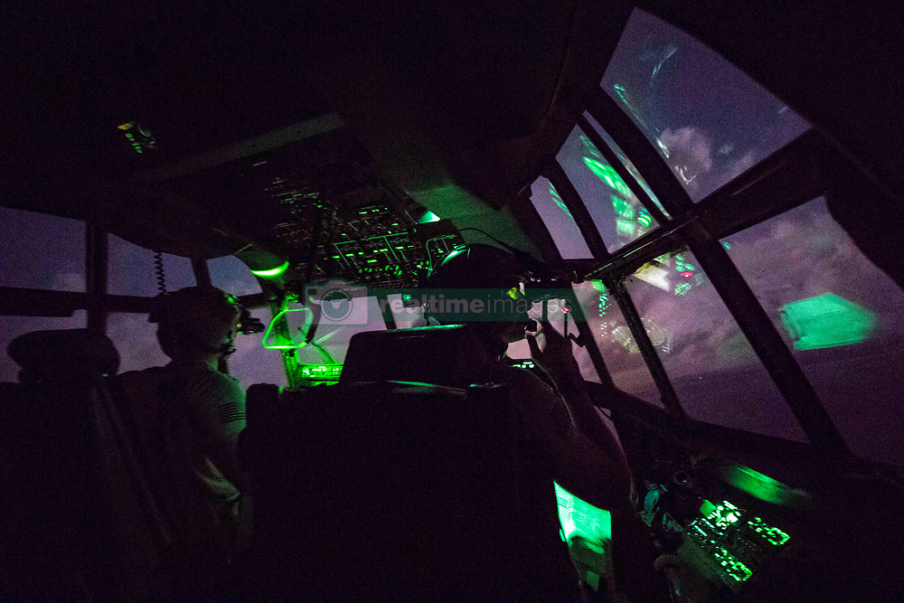 C-130J Super Hercules aircrew members assigned to the 75th Expeditionary Airlift Squadron, fly a mission over East Africa, July 24, 2018. The 75th EAS supports Combined Joint Task Force - Horn of Africa with medical evacuations, disaster relief, humanitarian and airdrop operations. (U.S. Air Force photo by Tech. Sgt. Larry E. Reid Jr.)