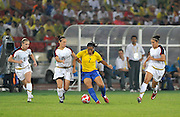 Beijing, CHINA.   Olympic Football, Women's Gold  Medal Game, USA vs BRA,  Left to right. 5. Kelly O'HARA, Megan RAPINOE, 7 RORMIGA with the ball and Ali KRIEGER, right, at the Beijing Workers Stadium. Thursday,  21.08.2008 [Mandatory Credit: Peter SPURRIER, Intersport Images]