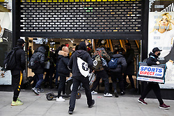 © Licensed to London News Pictures. 02/12/2020. London, UK. Shoppers rush into branch of JD sports on Oxford Street. Today England returns to tiered COVID restrictions following the end of the second national lockdown. Photo credit: George Cracknell Wright/LNP