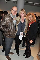 Left to right, MARK KNOPFLER, his wife KITTY ALDRIDGE and SUZANNE WYMAN at a private view of Bill Wyman - Reworked held at the Rook & Raven Gallery, 7 Rathbone Place, London W1 on 26th February 2013.