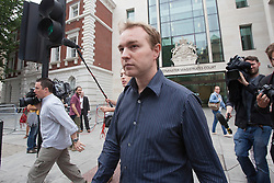 © licensed to London News Pictures. London, UK 20/06/2013. UBS trader Tom Hayes leaving Westminster Magistrates Court on Thursday, 20 June 2013. Hayes has been charged with offences of conspiracy to defraud in connection with the investigation by the Serious Fraud Office into the manipulation of Libor,  Photo credit: Tolga Akmen/LNP