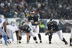 Philadelphia Eagles quarterback Nick Foles #9 takes a snap during the NFL game between the Detroit Lions and the Philadelphia Eagles on Sunday, December 8th 2013 in Philadelphia. The Eagles won 34-20. (Photo by Brian Garfinkel)