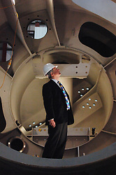 © London News Pictures. 12/01/2011. Chris Huhne, The British Secretary of State for Energy and Climate Change, visits Pelamis Wave Power in Edinburgh. Pelamis Wave Power Ltd is the manufacturer of a unique system to generate renewable electricity from ocean waves. Picture - Chris Huhne (MP), inside a power take off  module.Picture credit should read Angus Blackburn/LNP