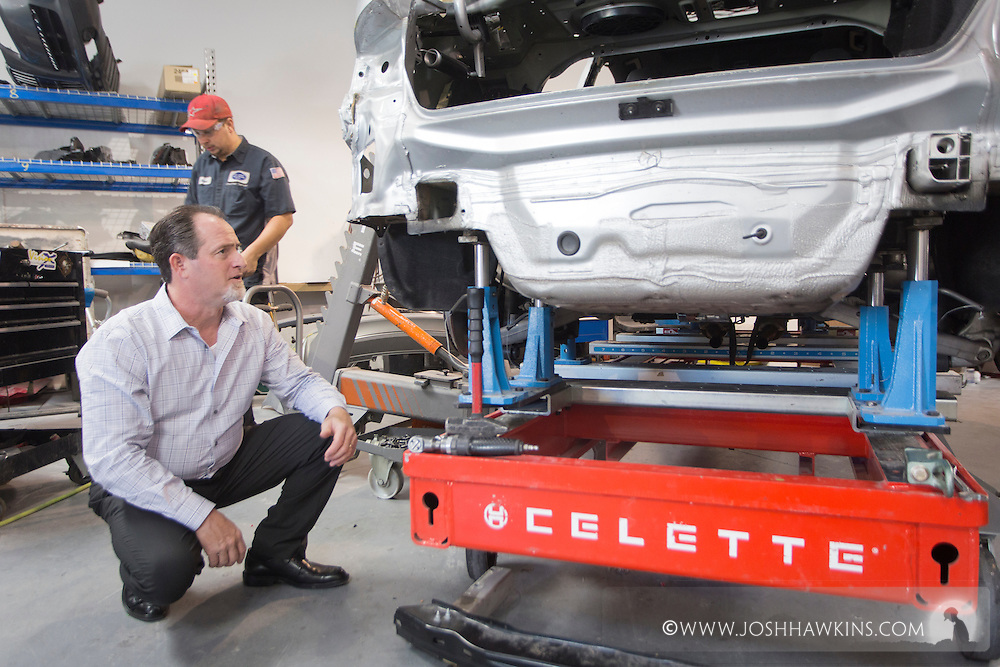 Michael Whittemore, examining a car on a special Audi lift. He said it was asked about a fair amount for the article. <br /> <br /> JH_201510021058_MG_5911.CR2<br /> 10/2/2015  --  10:58:02
