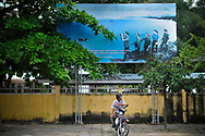 A motorbike taxi driver waits in a street of Nha Trang, Vietnam, Southeast Asia
