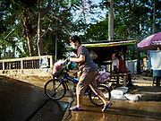 22 JANUARY 2019 - PHRA PRADAENG, SAMUT PRAKAN, THAILAND:  Passengers going to the Bangkok side of the river board a motorcycle and vehicle ferry across the Chao Phraya River in Phra Pradaeng. The use of vehicle ferries across the river has gone down as the government has built bridges to connect communities on both sides of the river. The Phra Pradaeng ferries are the busiest ferries in the Bangkok metropolitan area. Since the BTS Skytrain now stops a few kilometers from the ferry, the number of commuters going into Bangkok that use the ferry has increased.      PHOTO BY JACK KURTZ