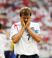 Photo: Chris Ratcliffe.<br /> <br /> England v Ecuador. 2nd Round, FIFA World Cup 2006. 25/06/2006.<br /> <br /> David Beckham of England feels the heat.