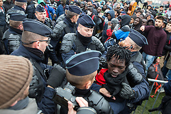 October 24, 2016 - Calais, Calais, France - Calais , France . A fight breaks out close to the front of the queue as people crush together and push forward . Migrant campers are evicted from the Jungle migrant camp in Calais , Northern France , on the day of a planned eviction and start of the destruction of the camp  (Credit Image: © Joel Goodman/London News Pictures via ZUMA Wire)