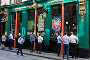 Lunchtime City workers watch the Ashes cricket match between England and Australia being streamed in the Pavillion End pub on Watling Street the former Roman thoroughfare in the City of London, the capitals financial district aka the Square Mile, on 22nd August 2019, in London, England.