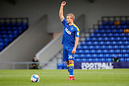AFC Wimbledon midfielder Jaakko Oksanen (16) taking a free kick and with arm in the air during the EFL Sky Bet League 1 match between AFC Wimbledon and Lincoln City at Plough Lane, London, United Kingdom on 2 January 2021.