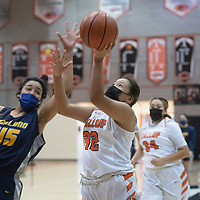 Gallup Bengal Michaela McCurtain (32) drives to the basket as Highland Hornet Delani Crawford (45)  defends during their New Mexico Class 4A girls basketball quarterfinal game at Gallup High School in Gallup Tuesday.