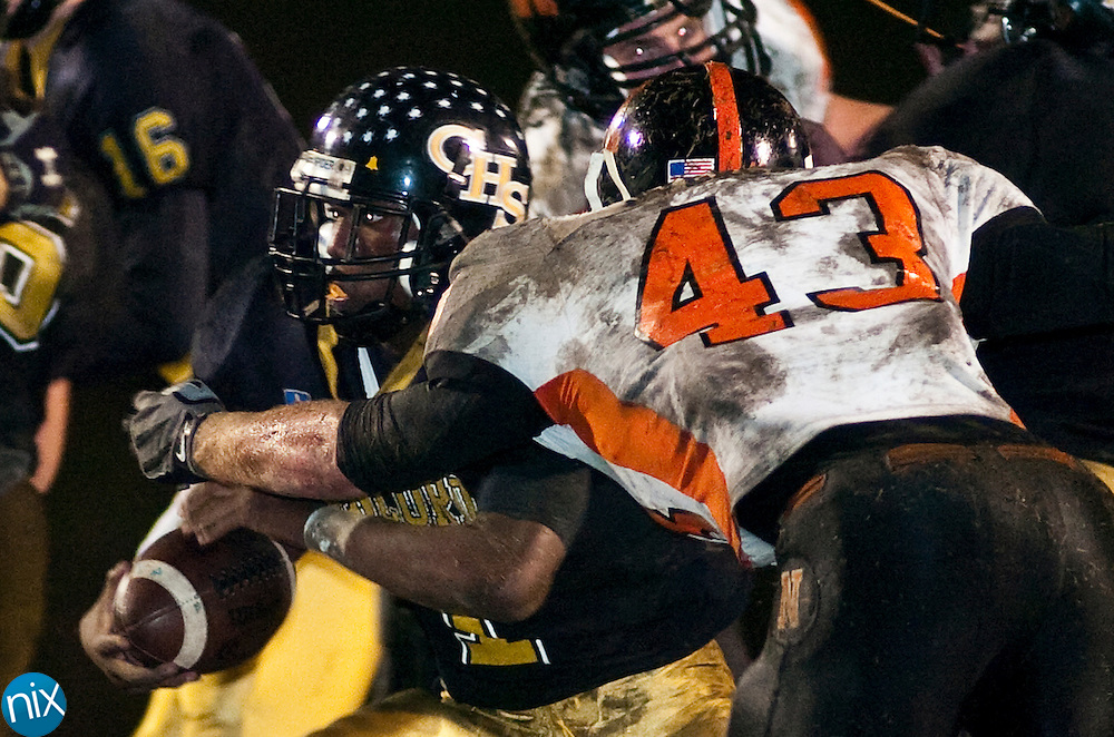 Concord's Dominique Posey tries to avoid a tackle from Northwest Cabarrus' Taylor Overcash in the first round of the NCHSAA 3A Playoffs at Concord High School Friday Nov. 13, 2009. (photo by James Nix/Independent Tribune)