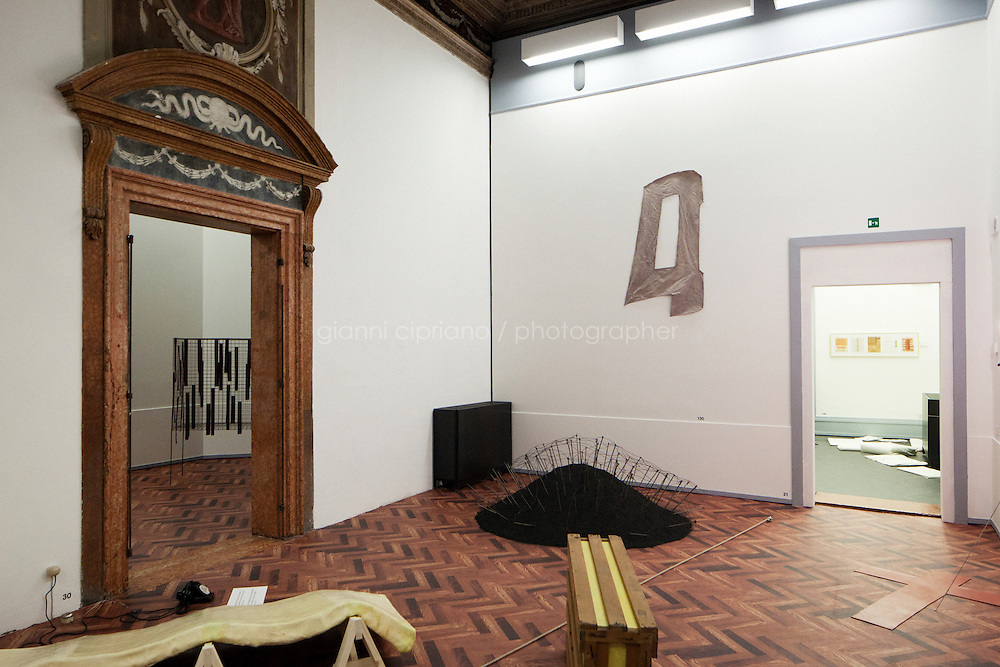"""VENICE, ITALY - 28 MAY 2013: A room of the first nobile floor of the Fondazione Prada, corresponding to the upper floor of the Kunsthalle Bern, of the """"When Attitudes Become Form: Bern 1968/Venice 2013"""" in Venice, Italy, on May 28th 20113. <br /> <br /> The exhibition """"When Attitudes Become Form: Bern 1969/Venice 2013"""", curated by Germano Calent in dialogue with Thomas Deman and Rem Koolhas, reconstructs """"Live in Your Head. When Attitudes Become Form"""", a show curated by Harald Szeemann at the Bern Kunsthalle in 1969, which went down in history for the curator's radical approach to exhibition practice, conceived as a linguistic medium.<br /> The 55th International Art Exhibition of the Venice Biennale takes place in Venice from June 1st to November 24th, 2013 at the Giardini and at the Arsenale as well as in various venues the city. <br /> <br /> Gianni Cipriano for The New York TImes"""
