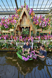 © Licensed to London News Pictures. 08/02/2018. LONDON, UK.  Olivia Steed-Mundin, Diploma Student, and Jenny Forgie, Orchid specialist trainee, work in front of a floating Bang Pa-In palace, part of the Golden Era of Thai history, putting the finishing touches to the displays in Kew Garden's first Thai-inspired Orchids Festival.  The festival celebrates Thailand's vibrant colours, culture, and magnificent plant life, runs from Saturday 10 February to Sunday 11 March 2018 and is hosted in partnership with the Royal Thai Embassy, London and Thai Airways.  Photo credit: Stephen Chung/LNP