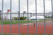 A female athlete running around an athletics track in the athletes village for the 2nd European Games on the 20th June 2019 in Minsk in Belarus. The 2nd European Games is held in Minsk, Belarus from the 21st June to the 30th June.