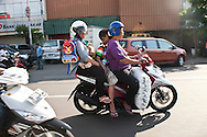 A family with a giant bag of rice ride home on a motor scooter.<br /> Various scenes of the city of Jakarta in Indonesia.