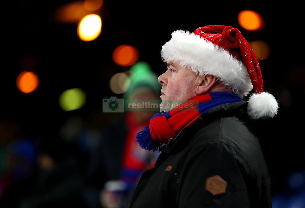 A fan in a festive hat during prior to the match