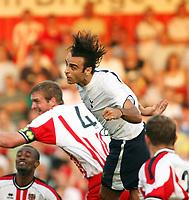 Photo: Chris Ratcliffe.<br /> Stevenage Borough v Tottenham Hotspur. Pre Season Friendly. 25/07/2006.<br /> Dimitar Berbatov of Spurs goes in for a header.