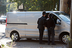© Licensed to London News Pictures. 05/10/2014. Brentford, UK. A private ambulance arrives to collect the body.  Police remove the body of Arnis Zalkains from Boston Manor Park today 5th October 2014. The body of a man, believed to be Latvian killer Arnis Zalkalns, was found in Boston Manor Park, Brentford, almost six weeks after the schoolgirl Alice Gross vanished.Arnis Zalkalns was prime suspect in the murder of 14-year-old Alice Gross.. Photo credit : Stephen Simpson/LNP