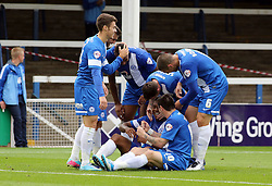 Peterborough United's Britt Assombalonga celebrates with team-mates - Photo mandatory by-line: Joe Dent/JMP - Tel: Mobile: 07966 386802 21/09/2013 - SPORT - FOOTBALL - London Road Stadium - Peterborough - Peterborough United V MK Dons - Sky Bet League 1