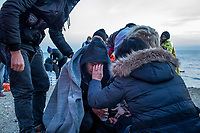 LESVOS, GREECE - FEBRUARY 09: A mother from Syria comforts her son suffering from hypothermia after their arrival on a beach in South Lesvos with other refugees and migrants from the Turkish coast on February 09, 2015 in Lesvos, Greece. Photo: © Omar Havana. All Rights Are Reserved