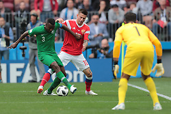 June 14, 2018 - Moscow, U.S. - MOSCOW, RUSSIA - JUNE 14: Defender Osama Hawsawi of Saudi Arabia and midfielder Fedor Smolov of Russia during a Group A 2018 FIFA World Cup soccer match between Russia and Saudi Arabia on June 14, 2018, at the Luzhniki Stadium in Moscow, Russia. (Photo by Anatoliy Medved/Icon Sportswire) (Credit Image: © Anatoliy Medved/Icon SMI via ZUMA Press)