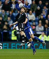 Photo: Steve Bond/Richard Lane Photography. Leicester City v Peterborough United. Coca-Cola Football League One. 20/12/2008. Alexsandar Tunchev (R) and Craig Mackail-Smith (L) in the air