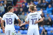 Will Grigg of Wigan Athletic celebrates scoring the equaliser to make it 1-1 with Tim Chow of Wigan Athletic and Michael Jacobs of Wigan Athletic during the EFL Cup match between Oldham Athletic and Wigan Athletic at Boundary Park, Oldham, England on 9 August 2016. Photo by Simon Brady.