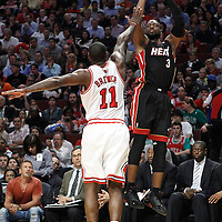 14 March 2012: Miami Heat shooting guard Dwyane Wade (3) takes a three point jumpshot over Chicago Bulls shooting guard Ronnie Brewer (11) during the Chicago Bulls 106-102 victory over the Miami Heat at the United Center, Chicago, Illinois, USA.