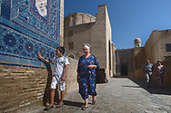 """Shah-I-Zinda necropolis in Samarkand is one of the oldest and longest-running examples of a continually constructed historic site in the world. The name Shah-i-Zinda (meaning """"The living king"""") is connected with the legend that Kusam ibn Abbas, the cousin of the prophet Muhammad was buried there. In the 7th century he came to Samarkand with Arab invasion to preach Islam. The legend says that he was beheaded for his faith. But he took his head and went into the deep well, where he's still living now."""
