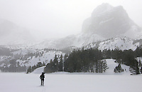 NEWS&GUIDE PHOTO / BRADLY J. BONER.Noah skins across a frozen Double Lake in blustery conditions on the trek into the heart of the Wind River Mountains during an attempt to ski Gannett Peak.