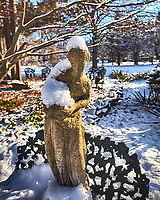 It snowed last night! Statue standing on a bench. Composite of three images taken with Fuji X-T1 camera and 16 mm f/1.4 lens (ISO 200, 16 mm, f/2.8, 1/2000 and 1/4000).