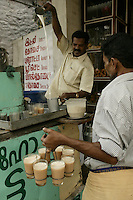 Hot tea with milk, Kerala, India - photograph  by Owen Franken