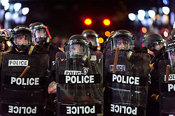 September 21, 2016 - Charlotte, North Carolina, U.S. - Police officers line up along Trade Street during a protest and eventual riot in uptown. This is the second day of violence that erupted after a police officer's fatal shooting of an African-American man Tuesday afternoon. (Credit Image: © Sean Meyers via ZUMA Wire)