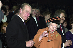 File photo dated 01/01/00 of Queen Elizabeth II and the Duke of Edinburgh raising their glasses as midnight strikes during the Opening Celebrations at the Millennium Dome in Greenwich in SE London. The Royal couple will celebrate their platinum wedding anniversary on November 20.