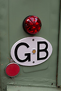 Detail of a GB Great Britain car badge on the back of a French Citroen vintage car, on 29th June 2017, in Greenwich, London, England.