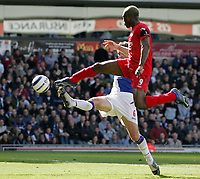 Photo: Paul Thomas.<br /> Blackburn Rovers v Liverpool. The Barclays Premiership. 16/04/2006.<br /> <br /> Liverpool's Djibril Cisse puts a shot a goal which comes off the upright and just misses.