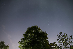 © Licensed to London News Pictures. 22/04/2020. WATFORD, UK.  A meteor over north west London can be seen in the top centre of the image, part of the Lyrid meteor shower which is associated with long-period Comet C/1861 G1 Thatcher. It is the oldest recorded meteor shower still visible today, and was first recorded in 687 BC.  The meteor shower is expected to continue to 25 April 2020.  Photo credit: Stephen Chung/LNP