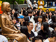 "SEOUL, SOUTH KOREA: The ""Pyeonghwabi"" (""Statue of peace"") in front of the Japanese embassy in Seoul, surrounded by Koreans protesting to obtain justice from the Japanese for the sexual enslavement of Korean women during World War II. The bird on her shoulder is symbolic of freedom and peace. The Wednesday protests have been taking place since January 1992. Protesters want the Japanese government to apologize for the forced sexual enslavement of up to 400,000 Asian women during World War II. The women, euphemistically called ""Comfort Women"" were drawn from territories Japan conquered during the war and many came from Korea, which was a Japanese colony in the years before and during the war. The ""comfort women"" issue is still a source of anger of many people in northeast Asian areas like South Korea, Manchuria and some parts of China.       PHOTO BY JACK KURTZ   <br /> Wednesday Demonstration demanding Japan to redress the Comfort Women problems"