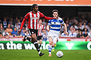 Brentford Midfielder Romaine Sawyers (19) and Queens Park Rangers Midfielder Paul Smyth (37) in action during the EFL Sky Bet Championship match between Brentford and Queens Park Rangers at Griffin Park, London, England on 21 April 2018. Picture by Stephen Wright.