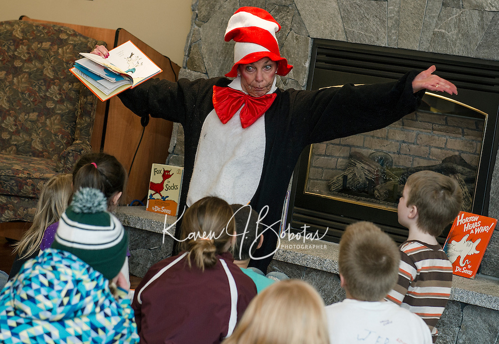 """The Cat in the Hat reads Dr. Seuss' """"Green Eggs and Ham"""" to children at the Gilford Library during their Read Across American event followed by a birthday celebration for Dr. Seuss on Wednesday afternoon.  (Karen Bobotas/for the Laconia Daily Sun)"""