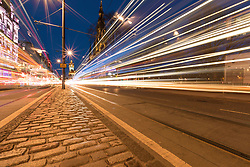 Edinburgh at Night - Light Trails on Princes Street.<br /> <br /> The Balmoral Hotel and Scott Monument form a back-drop to the rushing traffic on Edinburgh's Princes Street.
