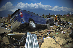 OCTOBER 10, 2018 - Poso, Indonesia - An Indonesian search and rescue team check the debris at Petobo in Poso, Central Sulawesi Province, Indonesia. Disaster agency has put the figure of casualties in the Indonesian multiple-strong quakes and an ensuing tsunami on September 28 to 2,010 people with over 5,000 others remaining missing. (Credit Image: © Zulkarnain/Xinhua via ZUMA Wire)