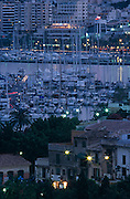 Boating and nightlife of the Passeo Maritime and harbour seen at dusk from Palma's Catalina area.