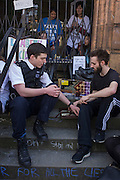A campaigner and policeman play backgammon on the steps of the closed Carnegie Library, in Herne Hill, south London on 2nd April 2016. The angry local community in the south London borough have occupied their important resource for learning and social hub for the weekend. After a long campaign by locals, Lambeth have gone ahead and closed the library's doors for the last time because they say, cuts to their budget mean millions must be saved. A gym will replace the working library and while some of the 20,000 books on shelves will remain, no librarians will be present to administer it.