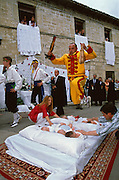 On the last day of the Fiesta del Colacho in Castrillo de Murcia, Burgos province, Spain, el Colacho, the devil incarnate, jumps over the children born during the year, removing the evil he represents, while parents hold their babies still. The Fiesta del Colacho is held every year at the time of the Catholic feast Corpus Christi, and the jumping over the children is intended to protect them from illness and misfortune.