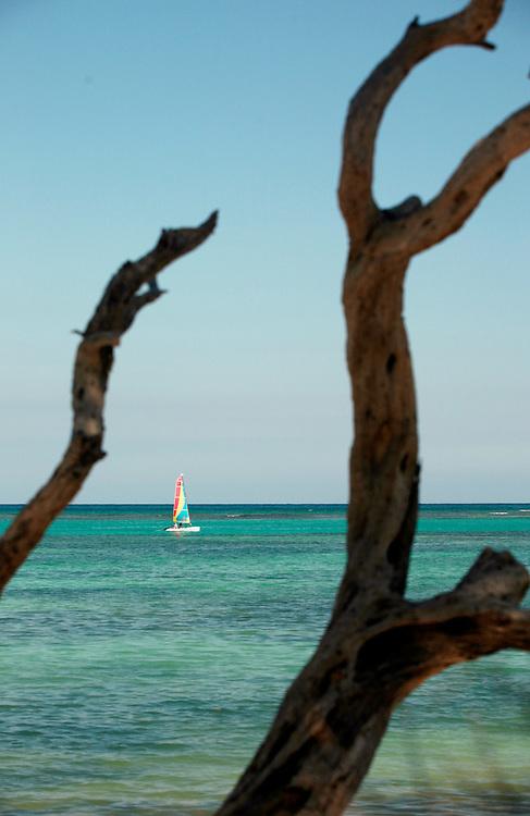 Punta Cana, Dominican Republic - April 11: A sailboat cruises on calm waters near Punta Cana Beach, in the Dominican Republic, April 11, 2007..
