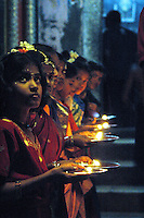India, Gokarna, 2006. Keralan Hindu girls light the way for a special yearly ceremony in Gokarna.