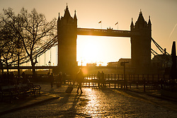 © Licensed to London News Pictures. 09/12/2017. London, UK. Tourists and people walk near Tower Bridge on the River Thames during sunrise this morning, as the capital woke up to freezing temperatures and cold, clear weather. Photo credit: Vickie Flores/LNP