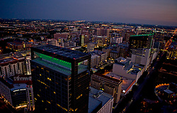 Aerial view of the Texas Medical Center at night with Memorial Hermann Medical Plaza in foreground.
